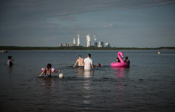 In Lausitz mining area in Eastern Germany people swim in an artificial lake built on top of an old lignite mine. Photo: Stephanie Loos